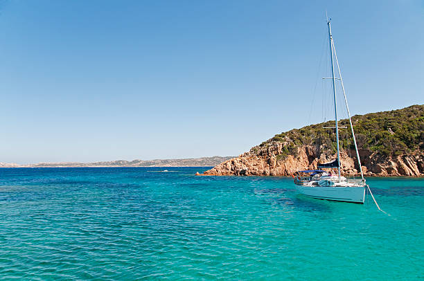 sailboat on crystal water - yacht front view stock photos and pictures