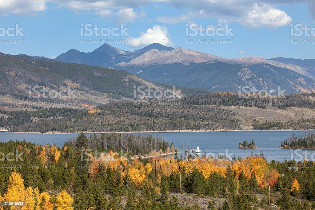 Sailboat on Lake Dillion with autumn Rocky Mountains stock photo