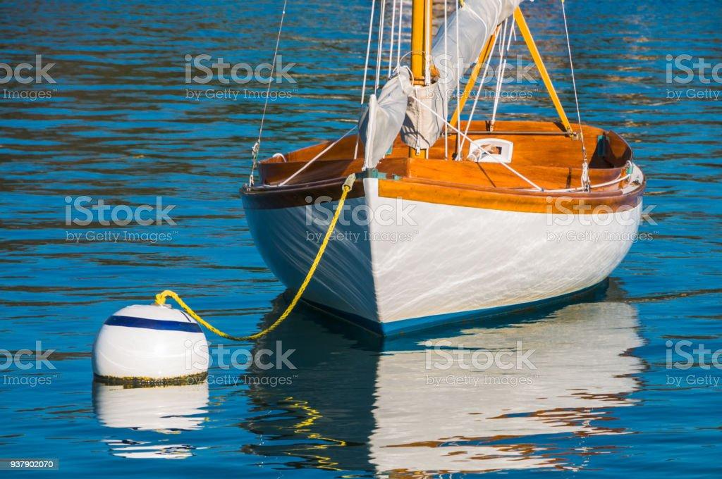 Sailboat on Mooring Ball stock photo