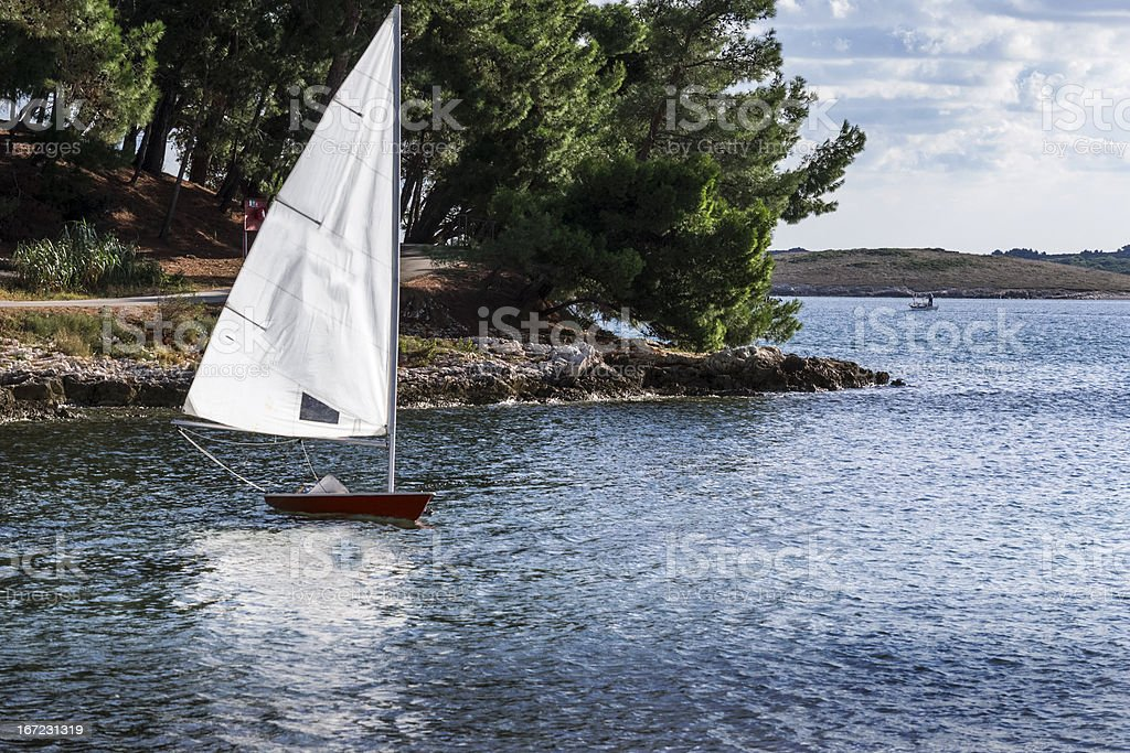 Sailboat on  sea in the bay royalty-free stock photo