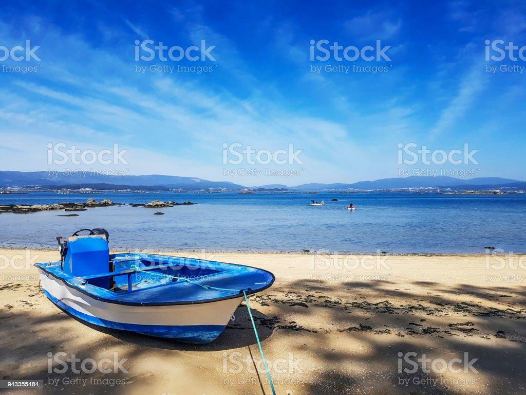 Sailboat on Sinas beach royalty-free stock photo