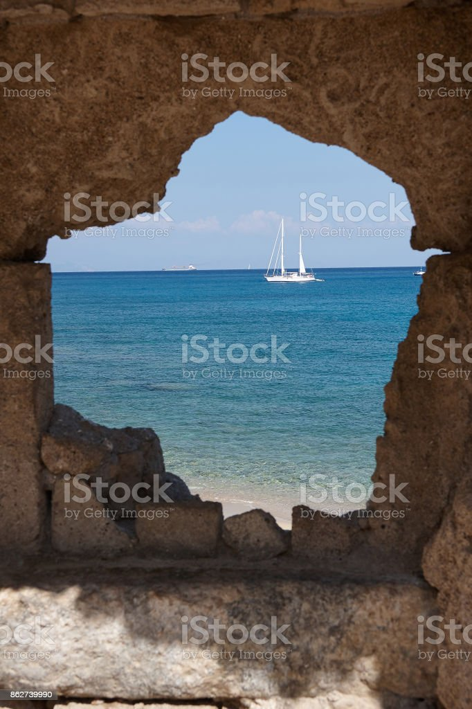 Sailboat on the background of the blue sea near Rhodes. stock photo