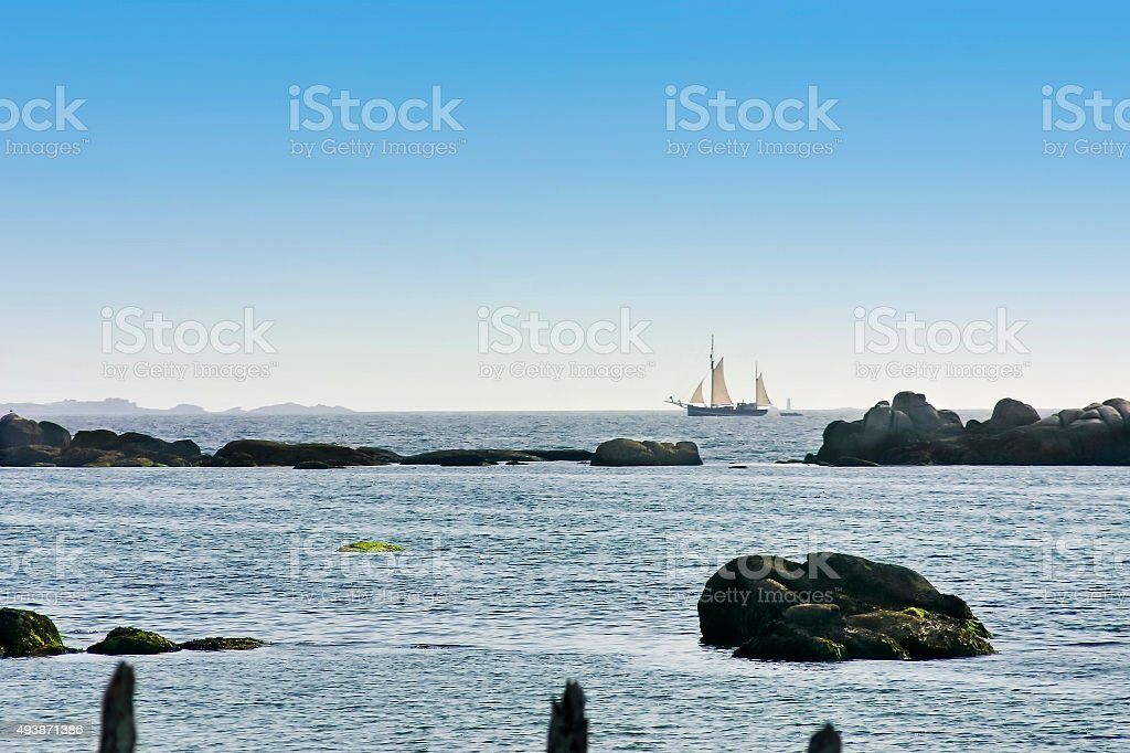 Sailboat on the horizon stock photo