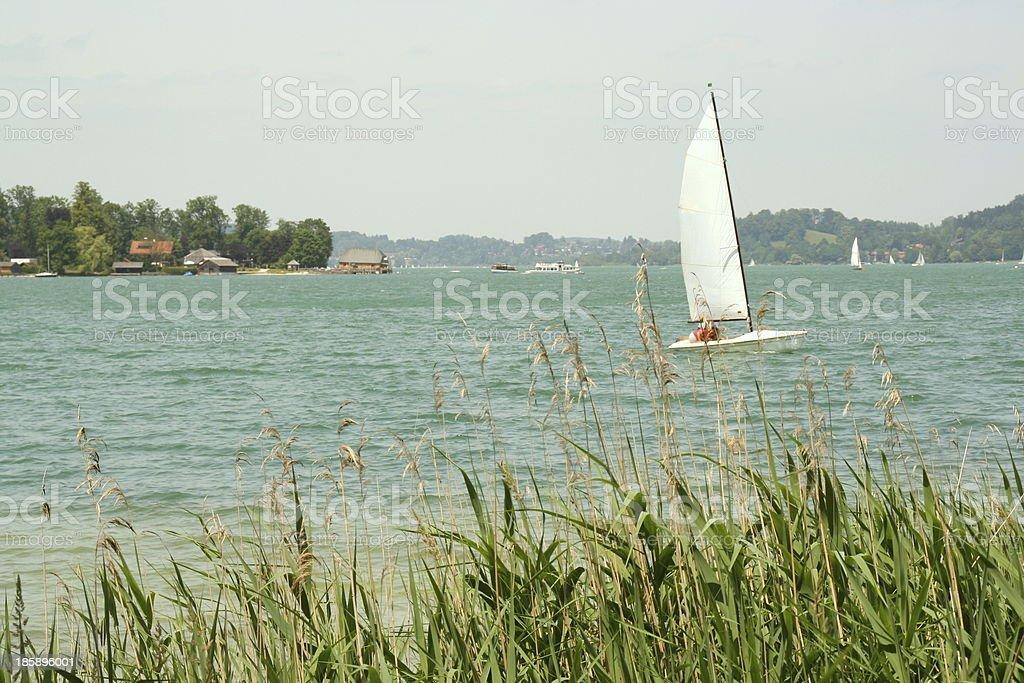 Sailboat on the lake stock photo