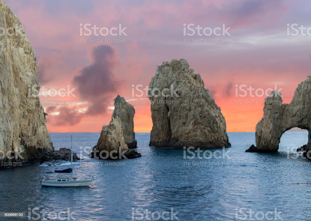 Sailboat on the Ocean at sunset stock photo