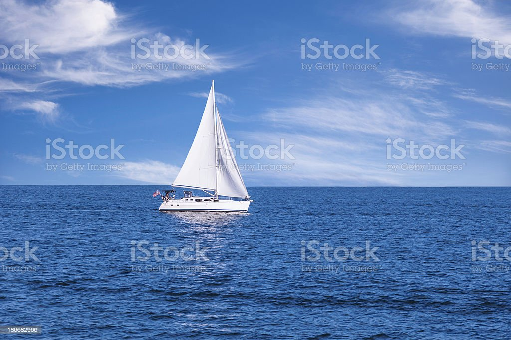 Sailboat on the open ocean royalty-free stock photo