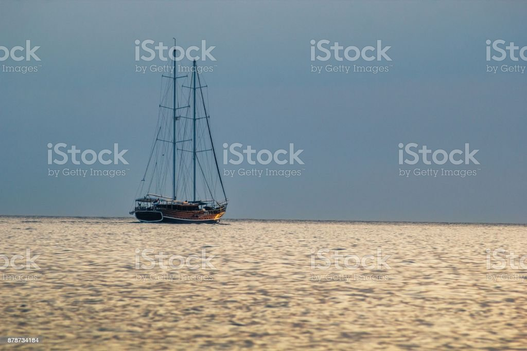 Sailboat on the sea at sunset stock photo