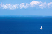 A sailboat travelling the seas along the southern west coast of Sweden.