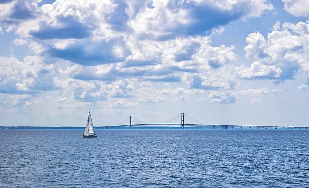 sailboat on the straits of mackinaw - mackinac island stock photos and pictures