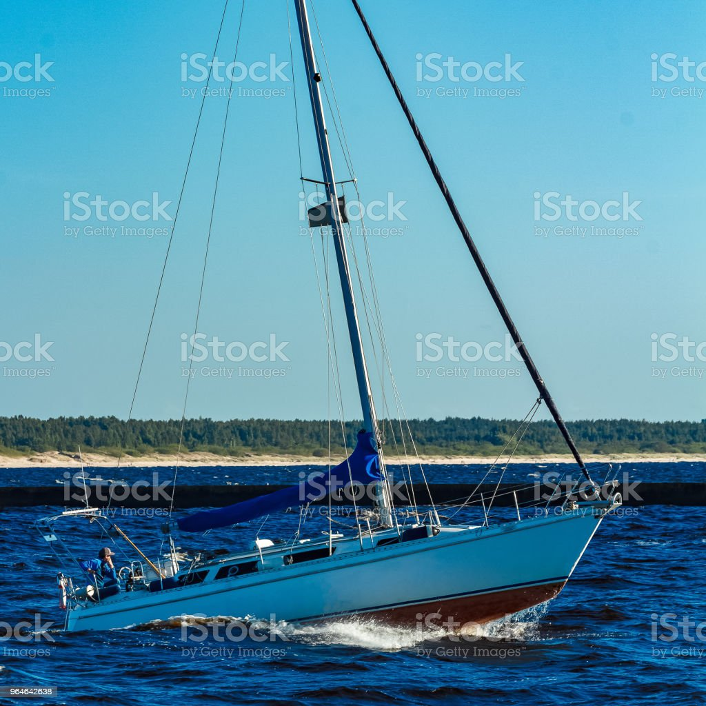 Sailboat on the waves royalty-free stock photo