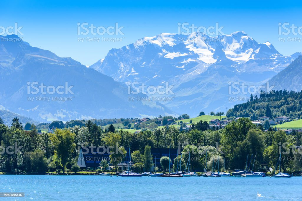 Sailboat on Thuner lake at Thun with beautiful panorama view to mountain scenery - Switzerland stock photo