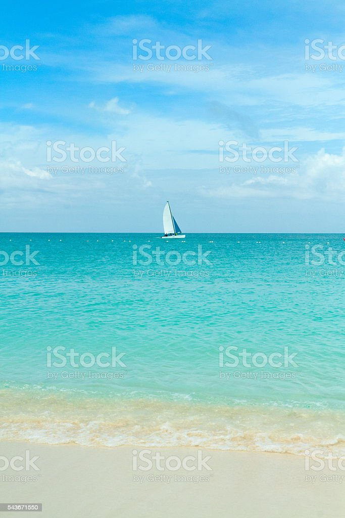 Sailboat on turquoise water in the Caribbean stock photo