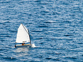 "Small racing sailboat in class ""optimist"". Training and practice."
