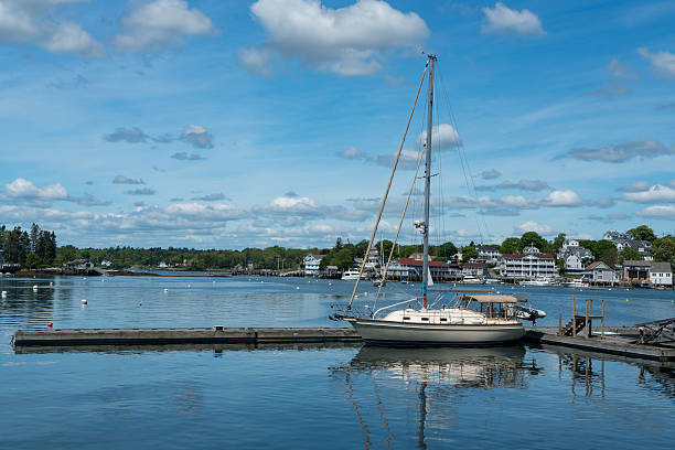 Sailboat Reflections in Blue Harbor Water stock photo