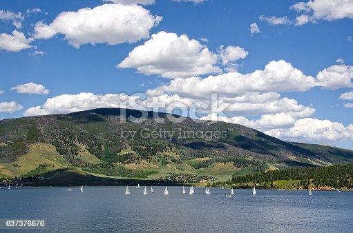 A sailboat regatta on Lake Dillon in Frisco, Colorado is always an interesting sight.  The mountains behind, however, are still showing the results of a pine beetle infestation, killing thousands upon thousands of trees.