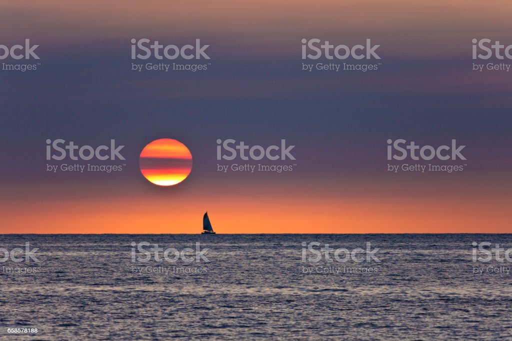 Sailboat Sailing at Sunset, Kailua-Kona, Hawaii stock photo
