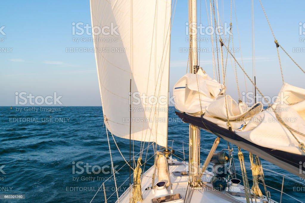 Sailboat sailing on Wadden Sea, Netherlands stock photo
