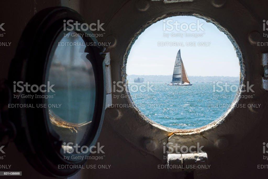 Sailboat seen through porthole on San Diego Bay stock photo