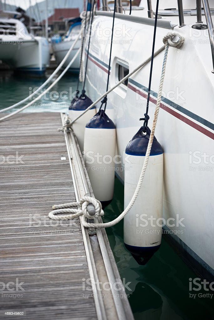Sailboat Side Fenders CloseUp. Boat protection royalty-free stock photo