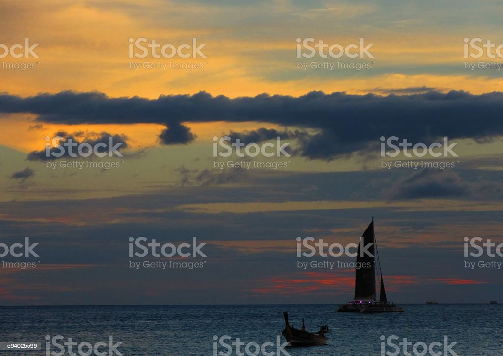 Sailboat Silhouette at Sunset stock photo