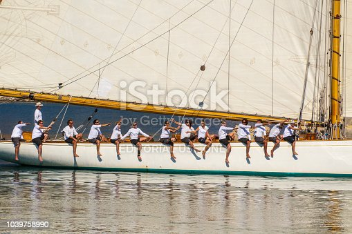 Imperia, Italy,15/09/2014: Sailboat with crew at work when go outside of the dock of Imperia