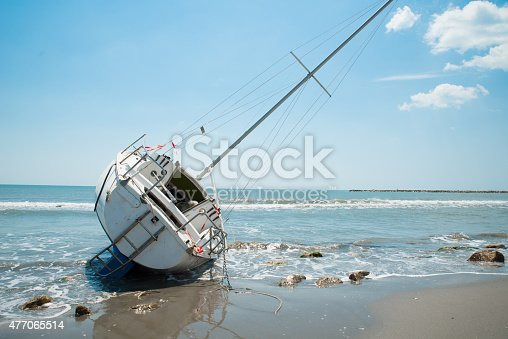 istock sailboat wrecked and stranded on the beach 477065514