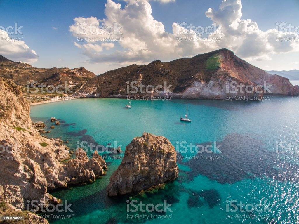 Sailboats anchored in bay at Milos island stock photo