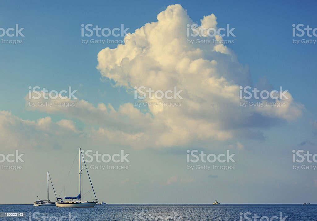 sailboats anchored stock photo