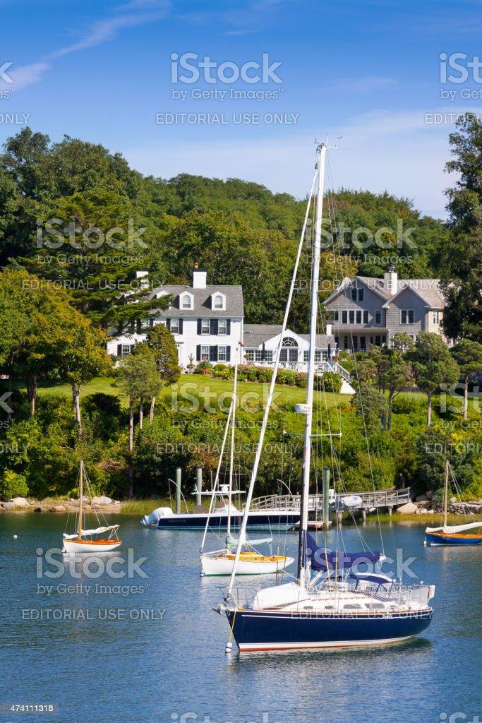 Sailboats and Luxury Waterfront New England House, Falmouth, Massachusetts. stock photo