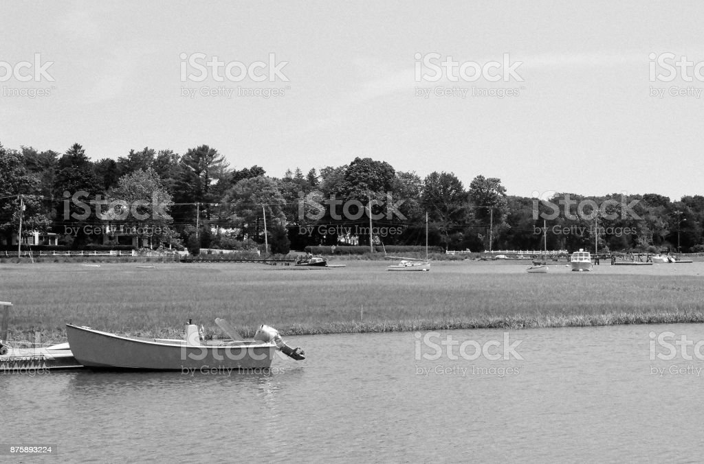 Sailboats and motor boats moored on an inlet to Duxbury Bay, MA. stock photo