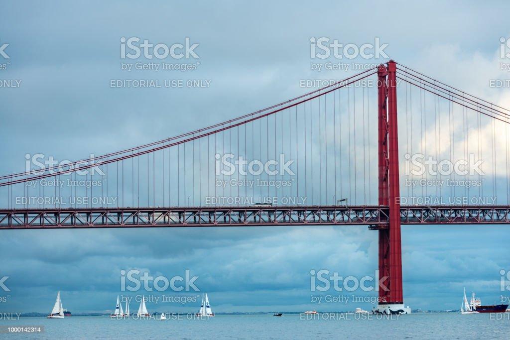 Sailboats around the 25 de Abril bridge in Lisbon stock photo