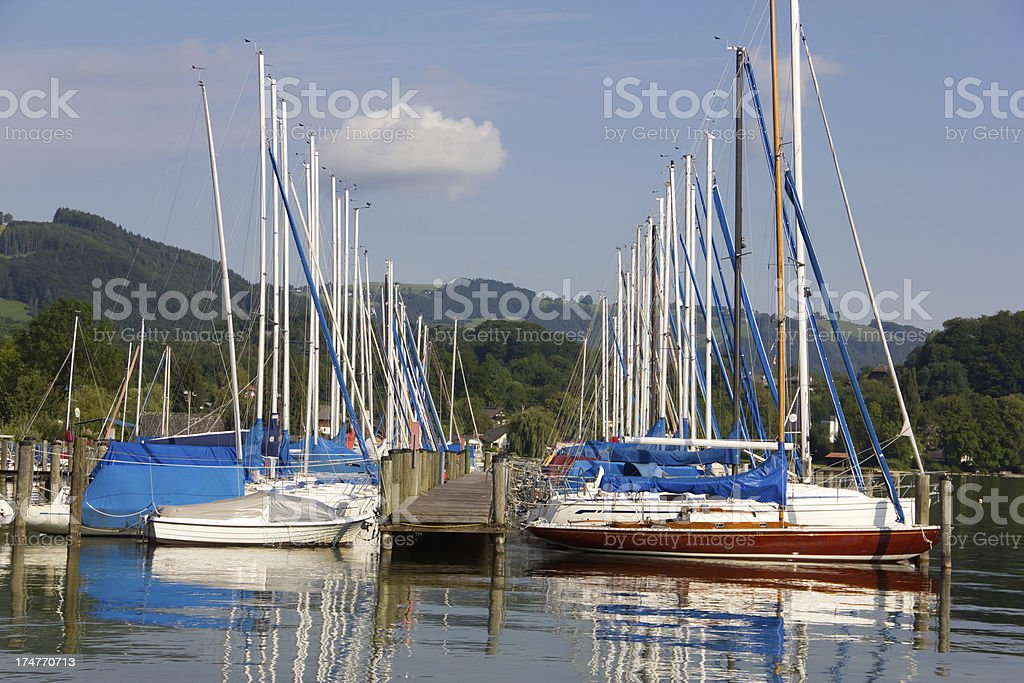 Sailboats at a pier on the lake royalty-free stock photo