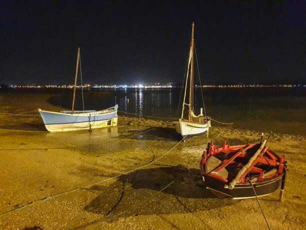 Sailboats at night stock photo
