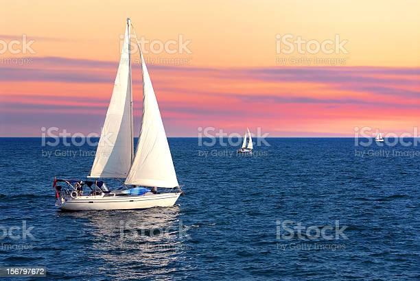 Photo of Sailboats at sunset