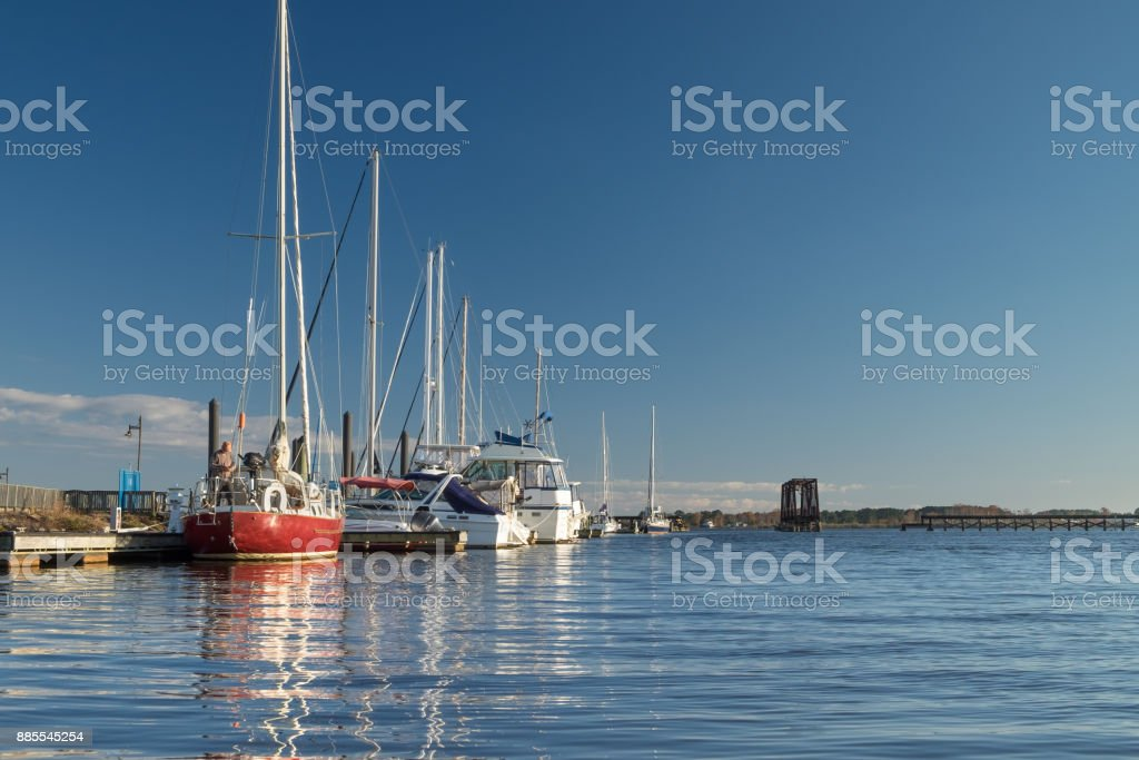 Sailboats Berthed Along the River stock photo