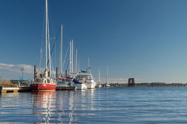 Sailboats Berthed Along the River stock photo