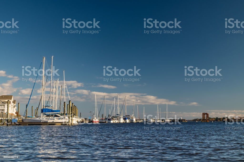 Sailboats Docked Along the Riverfront stock photo