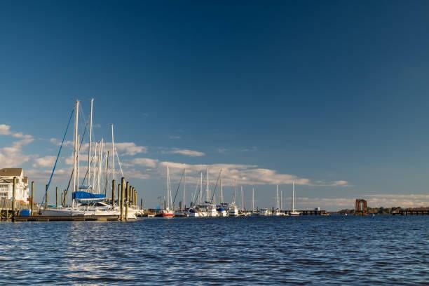 Sailboats Docked Along the Riverfront stock photo