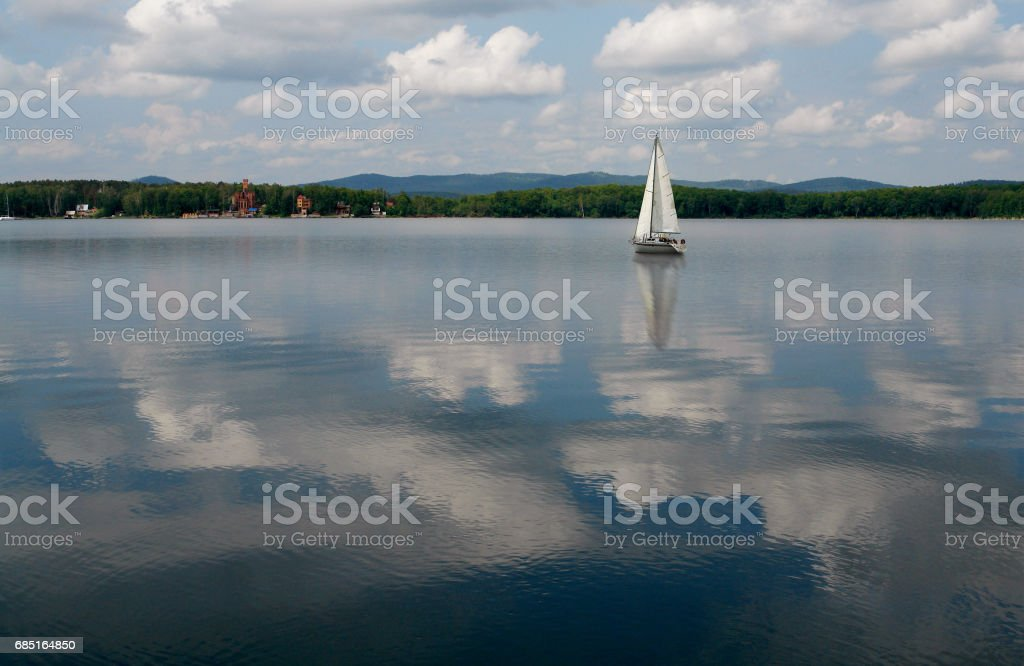 Sailboats floating in blue lake in summer. royalty-free stock photo