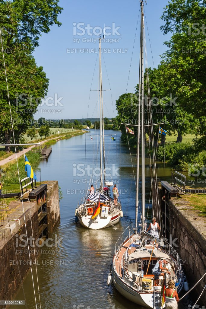 Sailboats going out of a lock stock photo