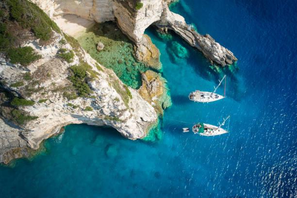 Sailboats in a beautiful bay, Paxos island, Greece stock photo
