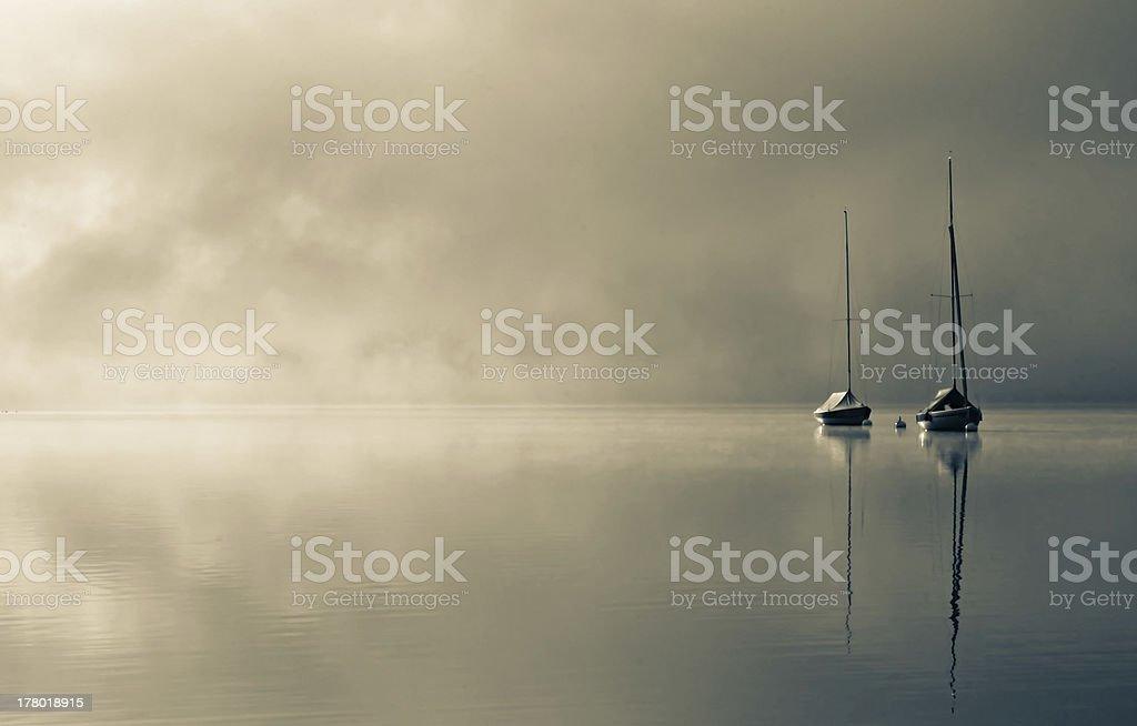 Sailboats in the morning-mist stock photo