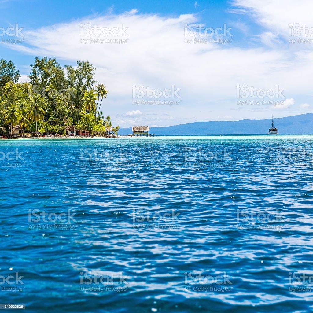 Sailboats in Turquoise Ocean Near Island stock photo