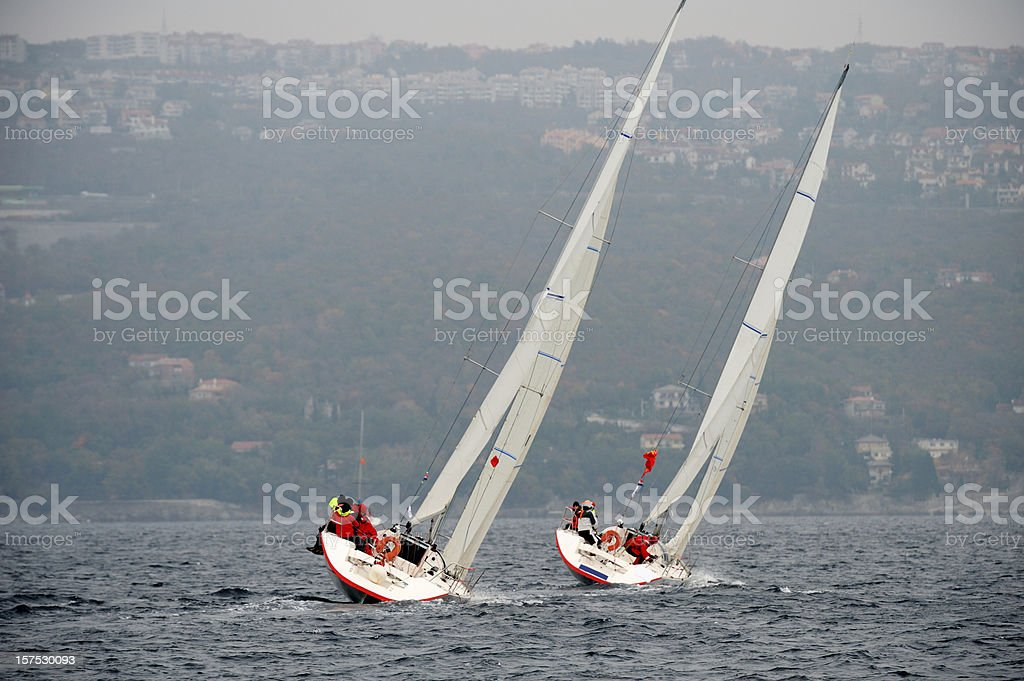 Sailboats leaning during regatta stock photo