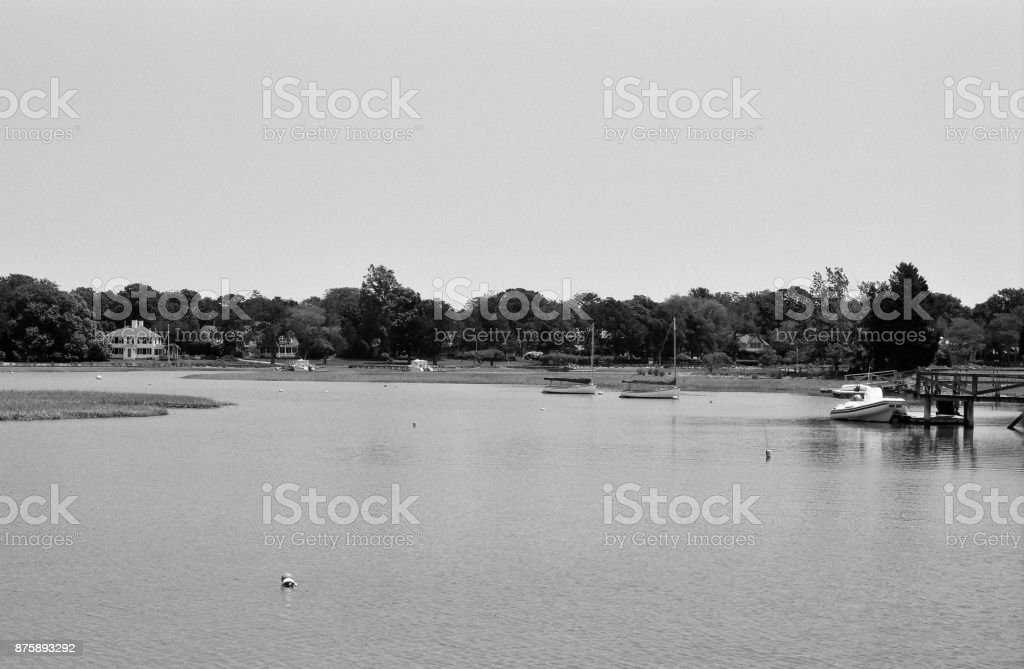 Sailboats moored on an inlet to Duxbury Bay, MA. stock photo