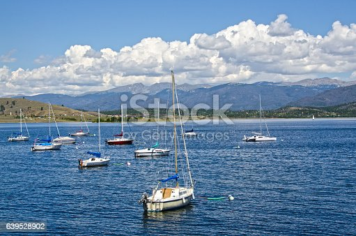 Lake Granby in north central Colorado is surrounded by the Rocky Mountains and lots of beetle kill trees.  It is a summer vacation spot, especially for those who enjoy sailing.