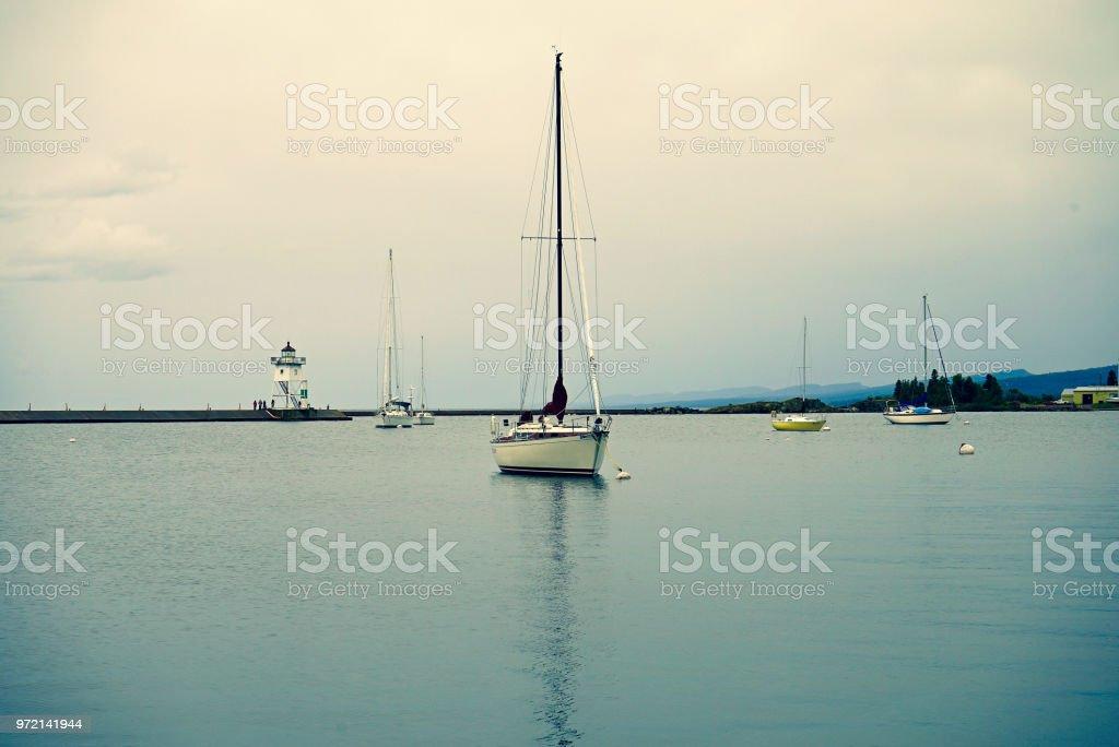 Sailboats on Lake Superior in Grand Marais stock photo