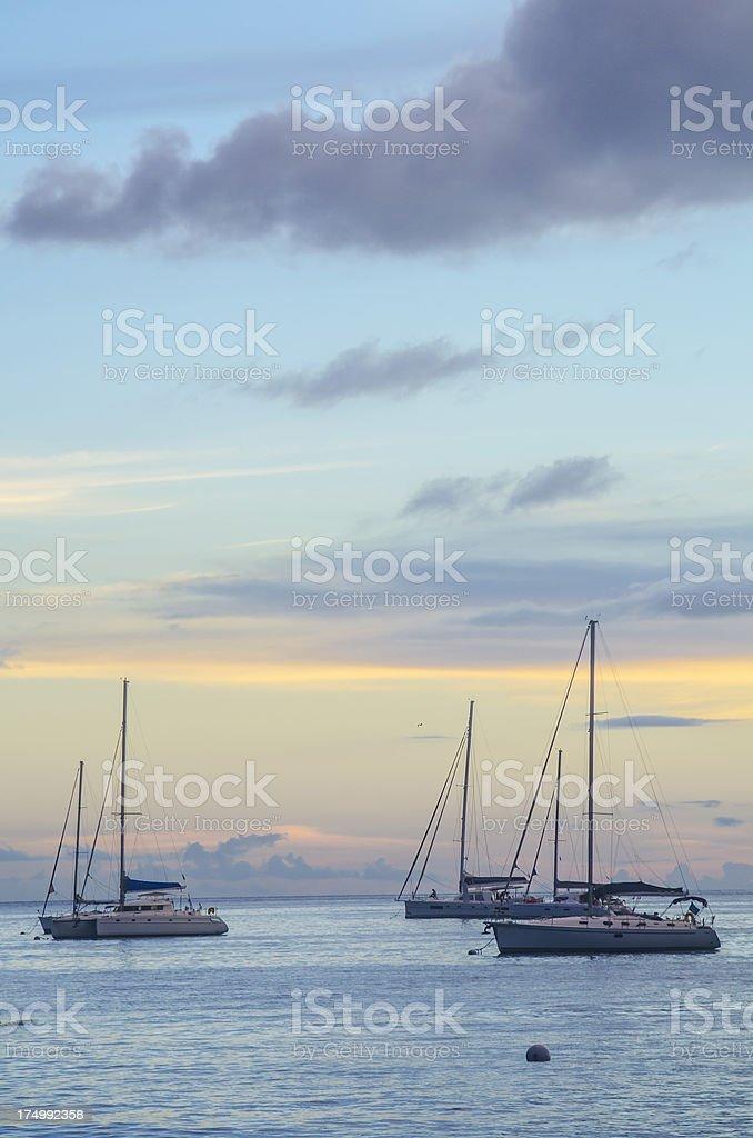 sailboats on serene sea at sunset royalty-free stock photo