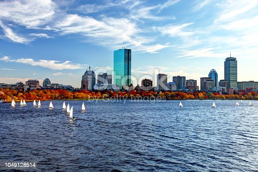 Sailboats on the Charles river in autumn. Boston is known for its central role in American history, world-class educational institutions, cultural facilities, and champion sports franchises