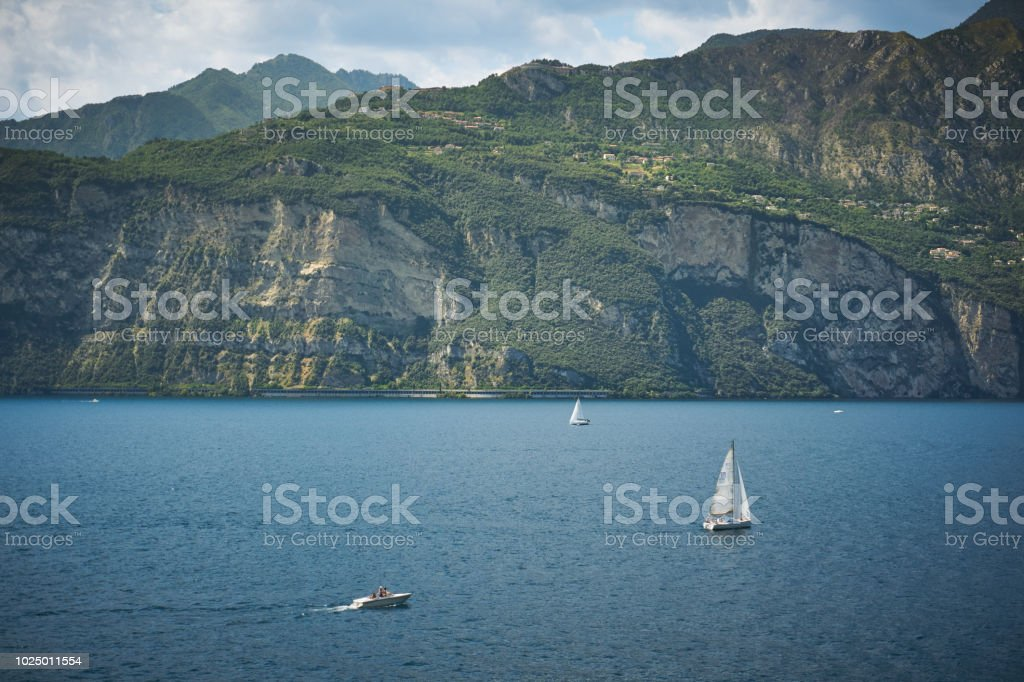 Malcesine, Italy - August, 2018. Sailboats on the lake Garda, the...